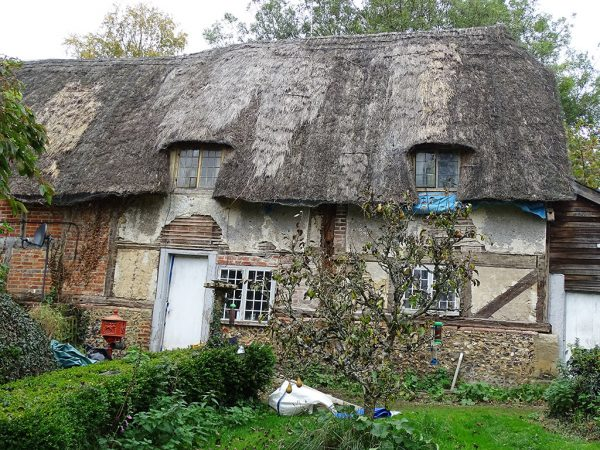 Timber 17thC frame cottage before repair in progress