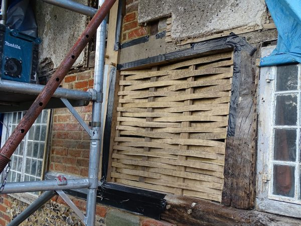 Wattle daub panels repair in progress